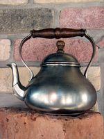 Informasjon om Cast Iron forniklet Miniatyr Ovner