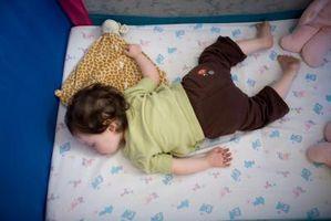 Hvor lenge bør du la en pjokk i en barneseng Når Awake?
