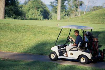 Slik lader en Golf Cart Med en Automotive batterilader